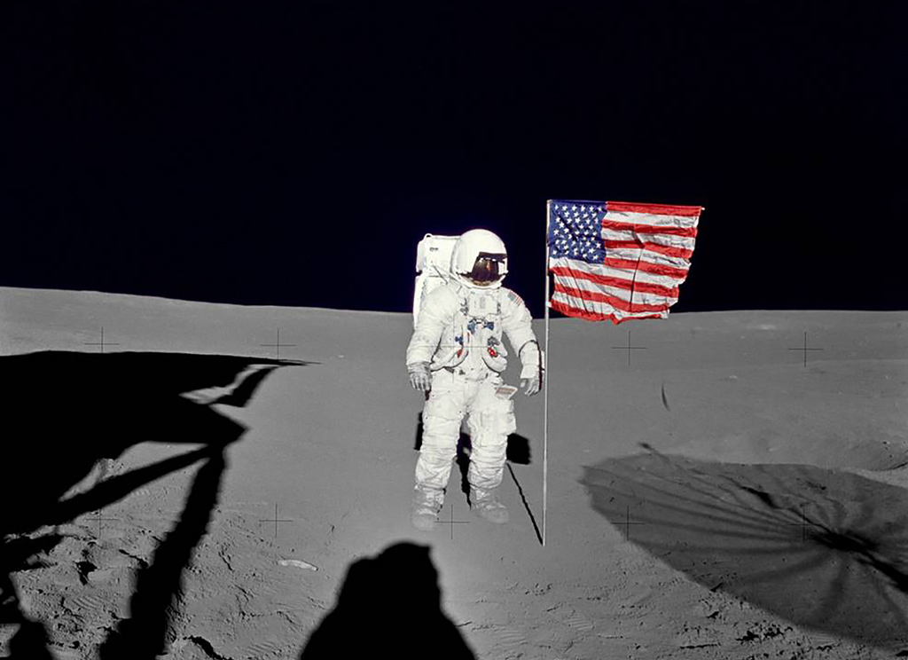 Astronaut Edgar Mitchell stands by the deployed U.S. flag on the lunar surface, in this NASA picture taken February 5, 1971. Mitchell, lunar module pilot on Apollo 14 and one of only 12 men to walk on the moon, passed away February 4, 2016 in West Palm Beach, Florida, NASA said in a news release. REUTERS/NASA/Handout via Reuters  THIS IMAGE HAS BEEN SUPPLIED BY A THIRD PARTY. IT IS DISTRIBUTED, EXACTLY AS RECEIVED BY REUTERS, AS A SERVICE TO CLIENTS. FOR EDITORIAL USE ONLY. NOT FOR SALE FOR MARKETING OR ADVERTISING CAMPAIGNS - RTX25O4Y