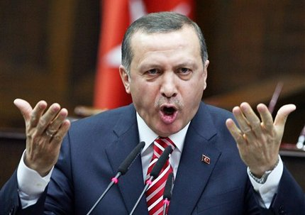 Turkey's Prime Minister Recep Tayyip Erdogan addresses the lawmakers of his ruling Justice and Development Party at the parliament in Ankara, Tuesday, April 22, 2008. (AP Photo/Burhan Ozbilici)