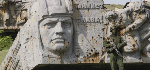 epa06719177 An armed militant stands on the damaged Savur-Mohyla memorial not far from the pro-Russian rebel's controlled Donetsk city, Ukraine, 08 May 2018. On 09 May Ukraine will mark the 73rd anniversary of the victory over Nazi Germany in Europe as the 'Day of Victory'. The Savur-Mohyla monument reportedly was damaged during heavy fighting between pro-Russian rebels and Ukrainian forces in July 2014.  EPA-EFE/ALEXANDER ERMOCHENKO