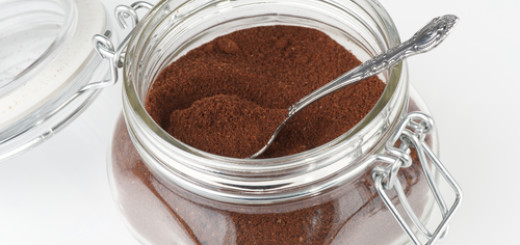 Open coffee jar wuth ground coffee