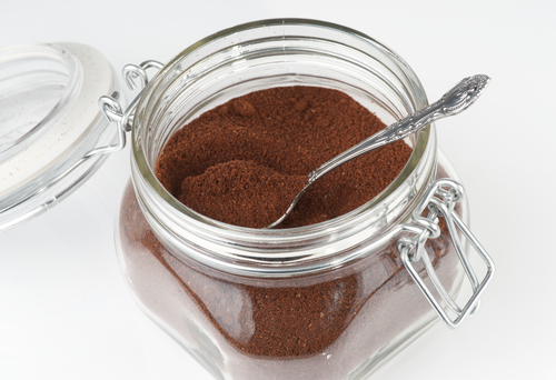 Open coffee jar wuth ground coffee